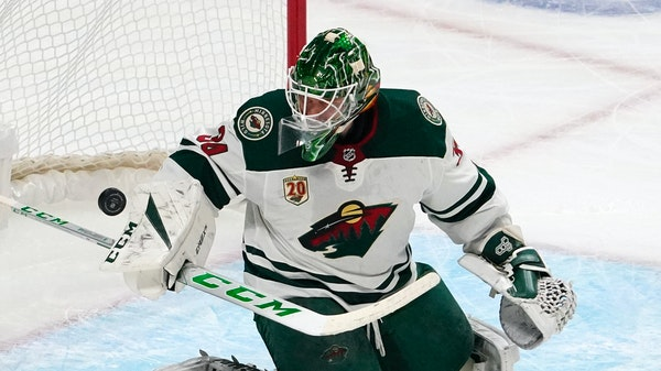 Minnesota Wild goaltender Kaapo Kahkonen deflects a shot during the first period of an NHL hockey game against the Los Angeles Kings Tuesday, Feb. 16,