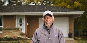 """In Chris McDuffie's 2020 photograph """"Don,"""" Don Colbert of Maplewood poses outside of his suburban home."""