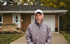"In Chris McDuffie's 2020 photograph ""Don,"" Don Colbert of Maplewood poses outside of his suburban home."