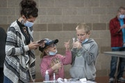 Minnesota health officials recommended Wednesday that schoolchildren and their families get tested for COVID-19 every two weeks through the end of the