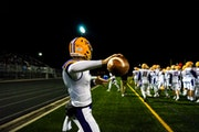 Cretin-Derham Hall players warmed up before a 2019 game against Prior Lake in the first round of the Class 6A playoffs. The Raiders will move to Class
