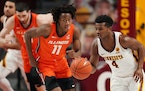 Gophers freshman Jamal Mashburn Jr. (4) has put up point totals of 14, 19 and 16 over the past three games.