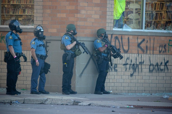 St. Paul police fired tear gas on protesters along University Avenue in May during protests following the death of George Floyd while in Minneapolis p
