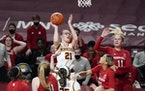 Gophers guard Caroline Strande shot the ball during the first half.