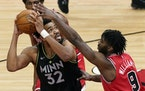 Timberwolves center Karl-Anthony Towns, left, looks to the basket against Chicago Bulls forward Patrick Williams during the second half