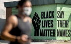 FILE - In this July 13, 2020, file photo, a black lives matter mural is visible in the Shaw neighborhood in Washington. The Black Lives Matter Global
