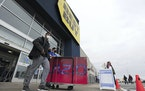 Shoppers leave a Best Buy store on Black Friday, in Wilkes-Barre, Pa., Friday Nov. 27, 2020. (Mark Moran/The Citizens' Voice via AP)