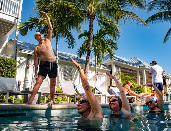 Hotels like the Marker Key West Harbor Resort in Key West, Fla., have added programming geared to older vaccinated travelers such as aqua yoga.