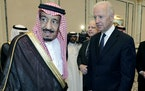 In this Oct. 27, 2011 file photo, then U.S. Vice President Joe Biden, right, offers his condolences to then Prince Salman bin Abdel-Aziz upon the deat
