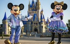 "Mickey Mouse and Minnie Mouse will play host to ""The World's Most Magical Celebration'' in new looks."