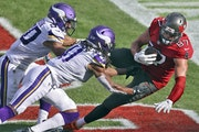 Buccaneers tight end Rob Gronkowski (87) pulls in a 2-yard touchdown pass after getting past Vikings linebacker Eric Wilson (50) and afety Anthony Har