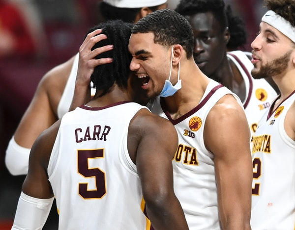 Gophers guard Tre' Williams and guard Marcus Carr celebrated against Purdue.
