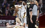 Gophers center Liam Robbins grabbed his lower left leg after a hard fall in the second half vs. Purdue.