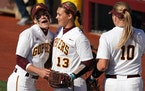 Gophers second baseman MaKenna Partain (3) congratulated pitcher Amber Fiser (13) during the 2019 season.