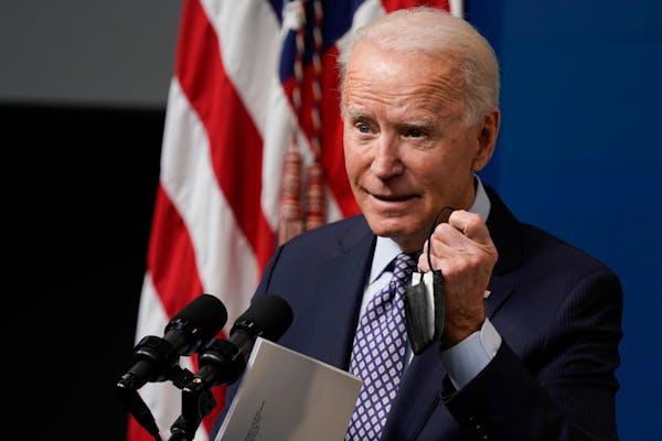 Biden marks 50 million COVID shots since taking office