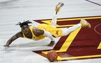 Minnesota Gophers guard Marcus Carr (5) fell to the court as he lost control of the ball in the second half against the Northwestern Wildcats.
