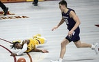 Northwestern forward Miller Kopp chased down the ball as Gophers guard Marcus Carr lost control and fell to the court in the second half.