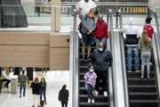 Shoppers made their way through Rosedale Center as some of the stores opened for business last spring.