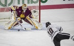 Minnesota Duluth goalie Ryan Fanti prepared for a shot from Nebraska Omaha forward Kevin Conley during a December game. The Bulldogs and Mavericks are