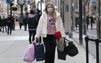 A woman carries shopping bags in New York in December 2020.