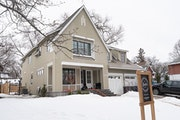This modern Tudor home overlooking Minnehaha Creek in Minneapolis by Jkath Design Build + Reinvent will be open for touring during the Parade of Homes