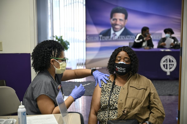 M Health Fairview nurse Darcey McCampbell administered a dose of the Pfizer-BioNTech COVID-19 vaccine to Loretta Flippin, 66, of Minneapolis on Feb. 1