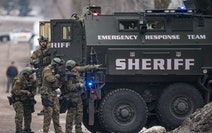 St. Louis County sheriffs were armed with rifles and grenade launchers as they maintained a perimeter and attempted to force the gunman out of his hou