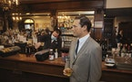 A wax statue of actor John Hamm stands by the bar with a drink at Peter Luger Steakhouse on Friday, Feb, 26, 2021, in New York. The statue, on loan fr