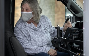 Bus driver Tammy Diethelm spoke with a student who had just boarded the bus at Chanhassen Elementary School. She has been driving a bus for 43 years.
