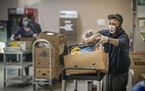 Florencio Cordero, loaded boxes of food as he volunteered at The Salvation Army food distribution event at its Citadel service center. Friday, Novembe