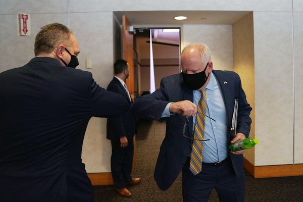 Gov. Tim Walz greeted Minnesota Management and Budget Commissioner  Jim Schowalter as he arrived for an update on the state budget forecast Friday in