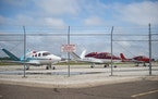 Small airplanes sat behind Cirrus Aircraft in Duluth on Monday June 29, 2020.