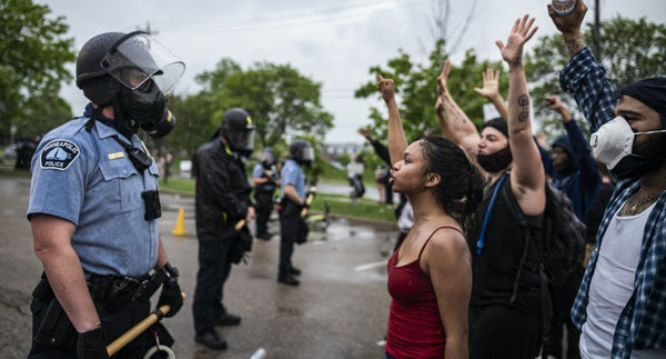 Protesters and police face each other in May 2020 during a rally against the death of George Floyd in Minneapolis.
