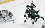 Ryan Hartman (38) of the Minnesota Wild Is unable to get the puck past Los Angeles Kings goalie Jonathan Quick (32) during the first period.