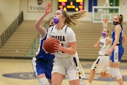 Chaska's Mallory Heyer spins for a layup against Wayzata Friday night. Heyer had a team-high 18 points in the Hawks' 61-59 victory over the Trojan