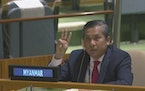In this image taken from video by UNTV, Myanmar Ambassador to the United Nations Kyaw Moe Tun flashes the three-fingered salute, a gesture of defiance