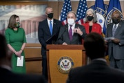 Speaker of the House Nancy Pelosi, D-Calif., left, is joined at a news conference by members of the Democratic Caucus, from left, Rep. Sean Patrick Ma