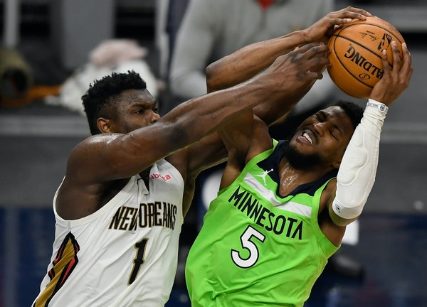 The Wolves will have to figure out how to replace the scoring of the suspended Malik Beasley, shown driving against the Pelicans' Zion Williamson.