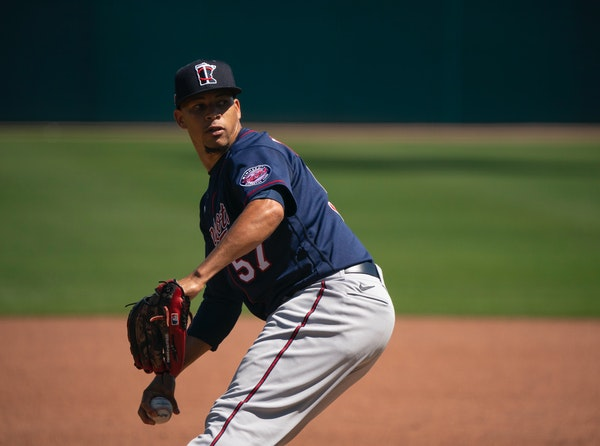 Minnesota Twins relief pitcher Hansel Robles (57) threw from the mound to hitters Thursday morning in Hammond Stadium.