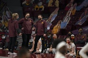 Gophers coaches conferred during a game against Iowa on Jan. 31.