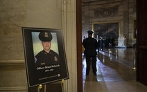 A placard with an image of the late U.S. Capitol Police officer Brian Sicknick in the Capitol Rotunda in Washington on Feb. 2.
