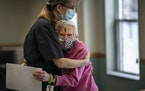 Wally Emery, left, who serves meals at Oak Meadows Senior Home in Oakdale, gave resident Donna Chapp a welcome hug.