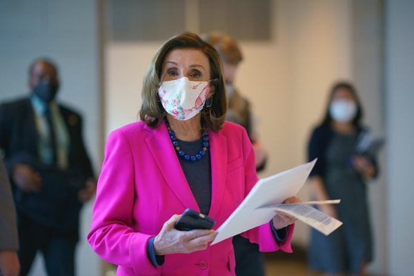 Speaker of the House Nancy Pelosi, D-Calif., walks to a news conference as the Democratic-led House is poised to pass a bill that enshrines protection