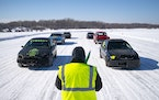 Craig Sheasby, one of the racing judges, lined up the cars on the starting line of the ice track before the start of one of the races on the Allouez B