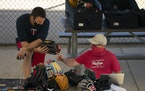 A Twins staffer looked over glove samples while talking with a Rawlings representative Saturday morning.