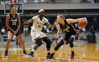 Connecticut guard Paige Bueckers drives against Butler guard Upe Atosu during the second quarter Saturday.