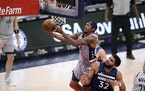 Washington guard Bradley Beal goes to the basket against Timberwolves center Karl-Anthony Towns during the first half