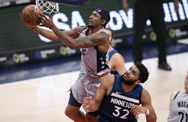 Washington Wizards guard Bradley Beal (3) goes to the basket against Minnesota Timberwolves center Karl-Anthony Towns (32) during the first half of an