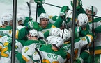 Minnesota Wild defenseman Matt Dumba (24) was mobbed by his teammates on the ice after scoring the game winning goal past Los Angeles Kings goaltender