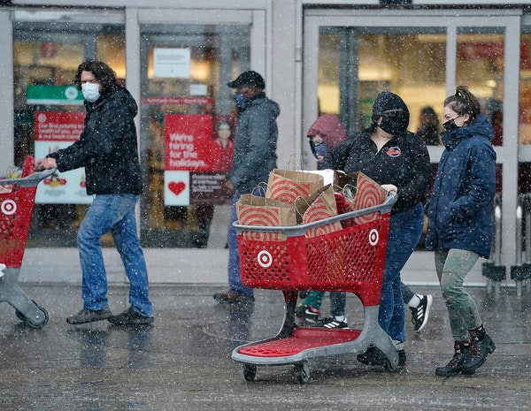 Shoppers try to beat the snowstorm before the holidays Wednesday, Dec. 23, 2020 at a Target Super Store in Richfield, Minnesota.